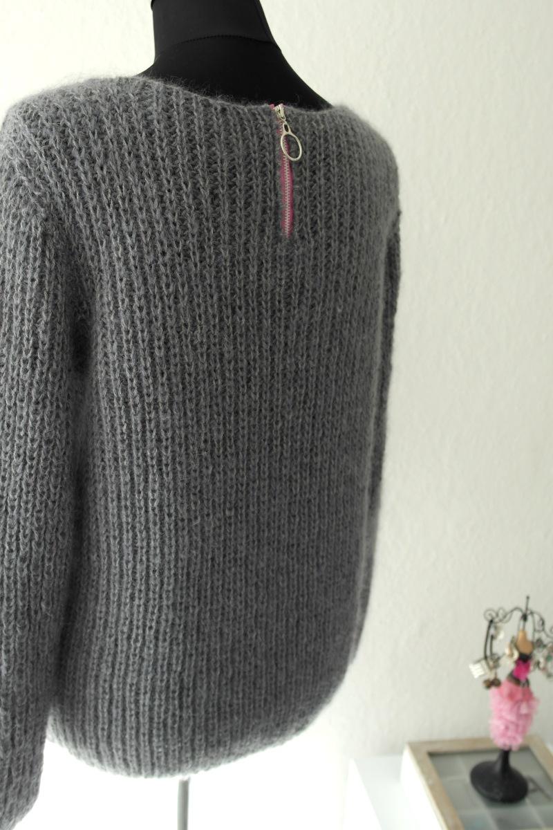 Sweater i patent med lynlås